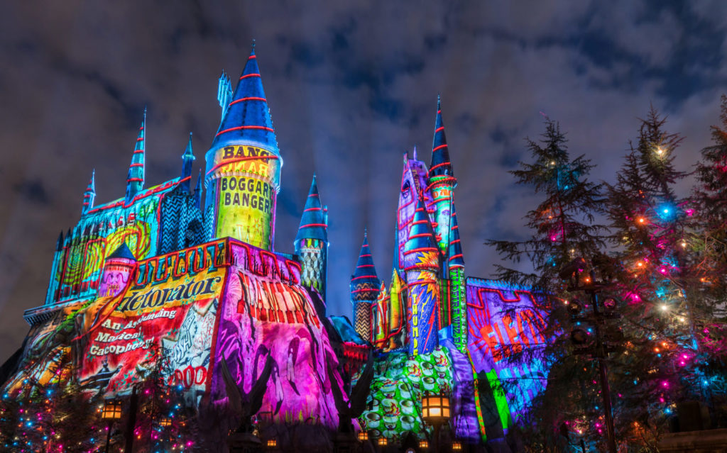 Nighttime shot of colorful holiday projection on the Hogwarts Castle in Universal's Islands of Adventure.